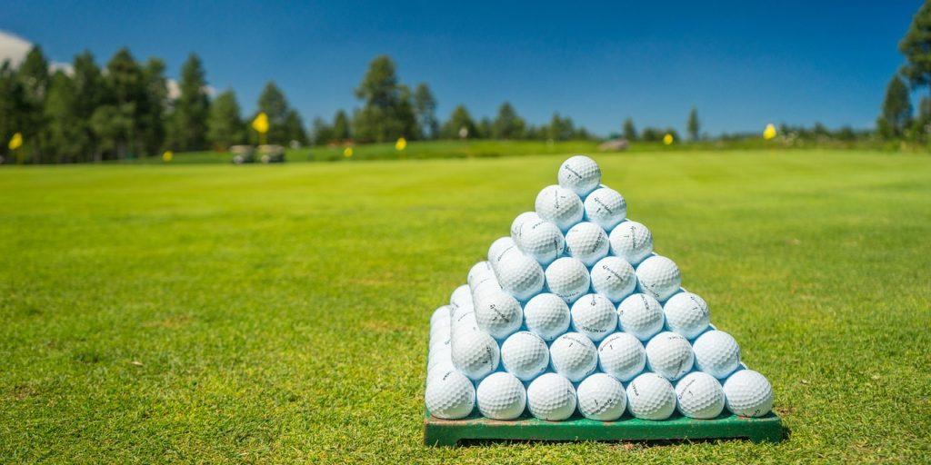 Best Beginner Golf Balls - Stack of Balls on Driving Range